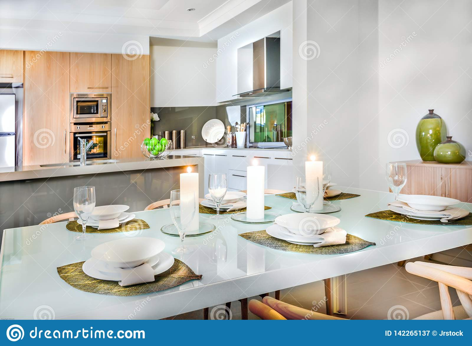 Luxurious Dining Room Table Setup Near To The Kitchen Stock Image ...