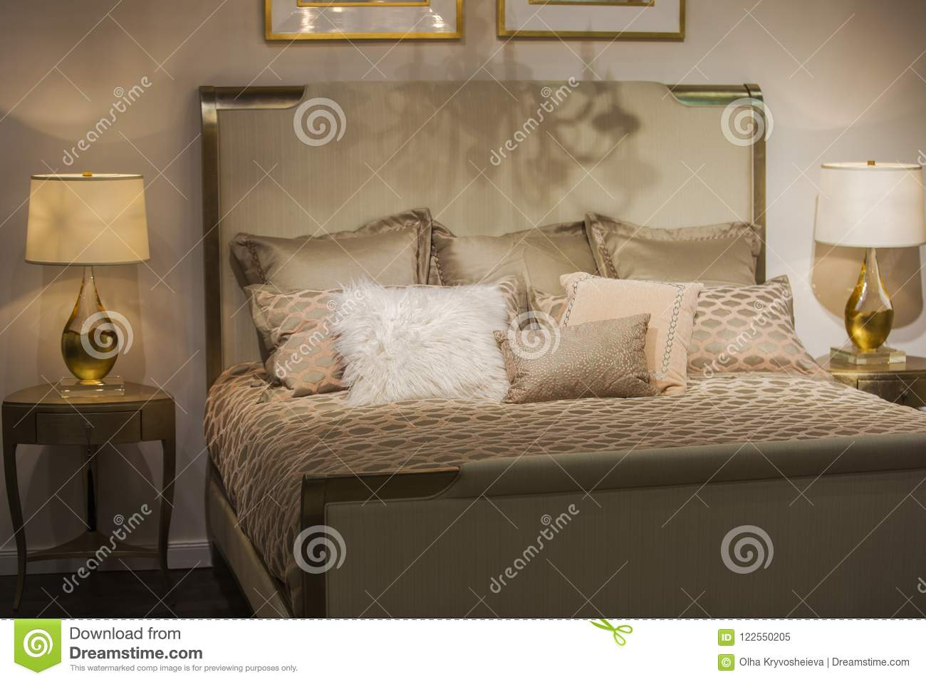 Luxurious Interior Designed Bedroom With Antique Beautiful Bedside Tables And Lamps On Them In Gold Colors With Golden Pillows Stock Image Image Of Bedside Duvet 122550205