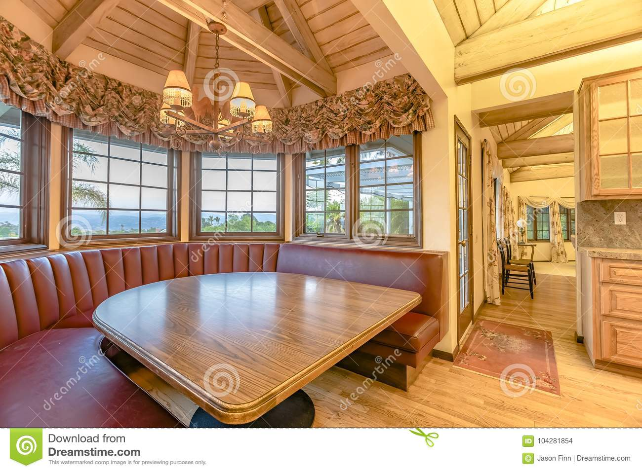 Luxurious Kitchen Table With Booth Style Seating Area In An Upsc - Restaurant style kitchen table