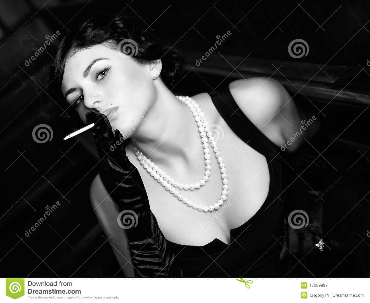 Luxurious lady with a cigarette. Vintage style.