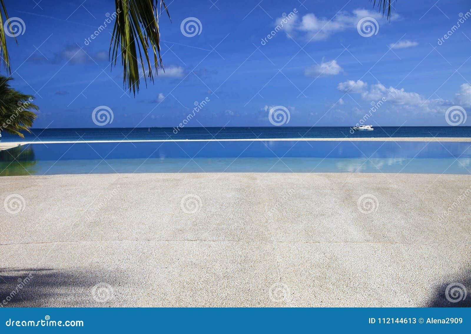 Infinite swimming pool stock image. Image of background - 112144613