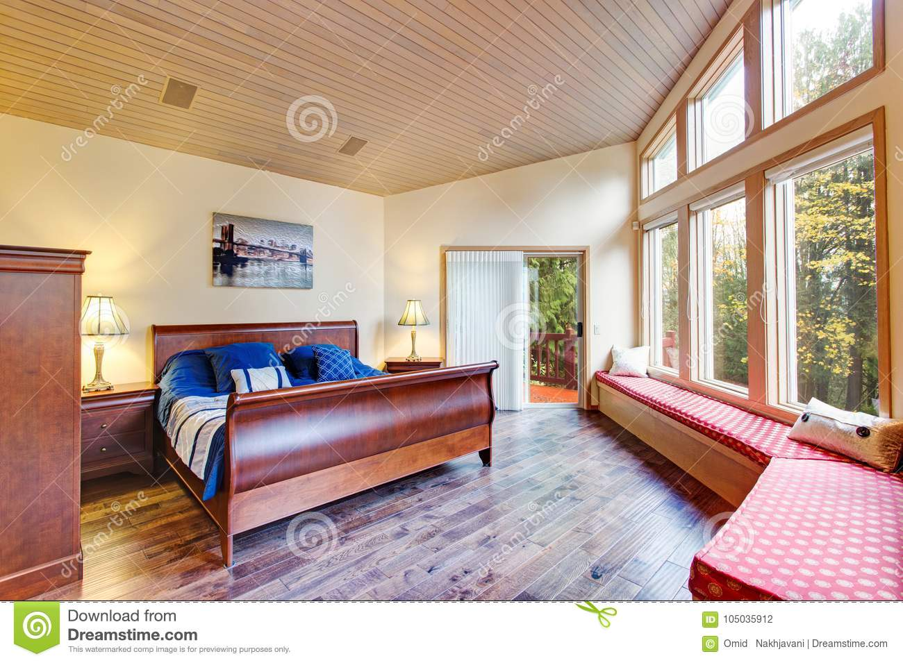 Luxurious Master Bedroom With Window Seat Stock Photo - Image of ...