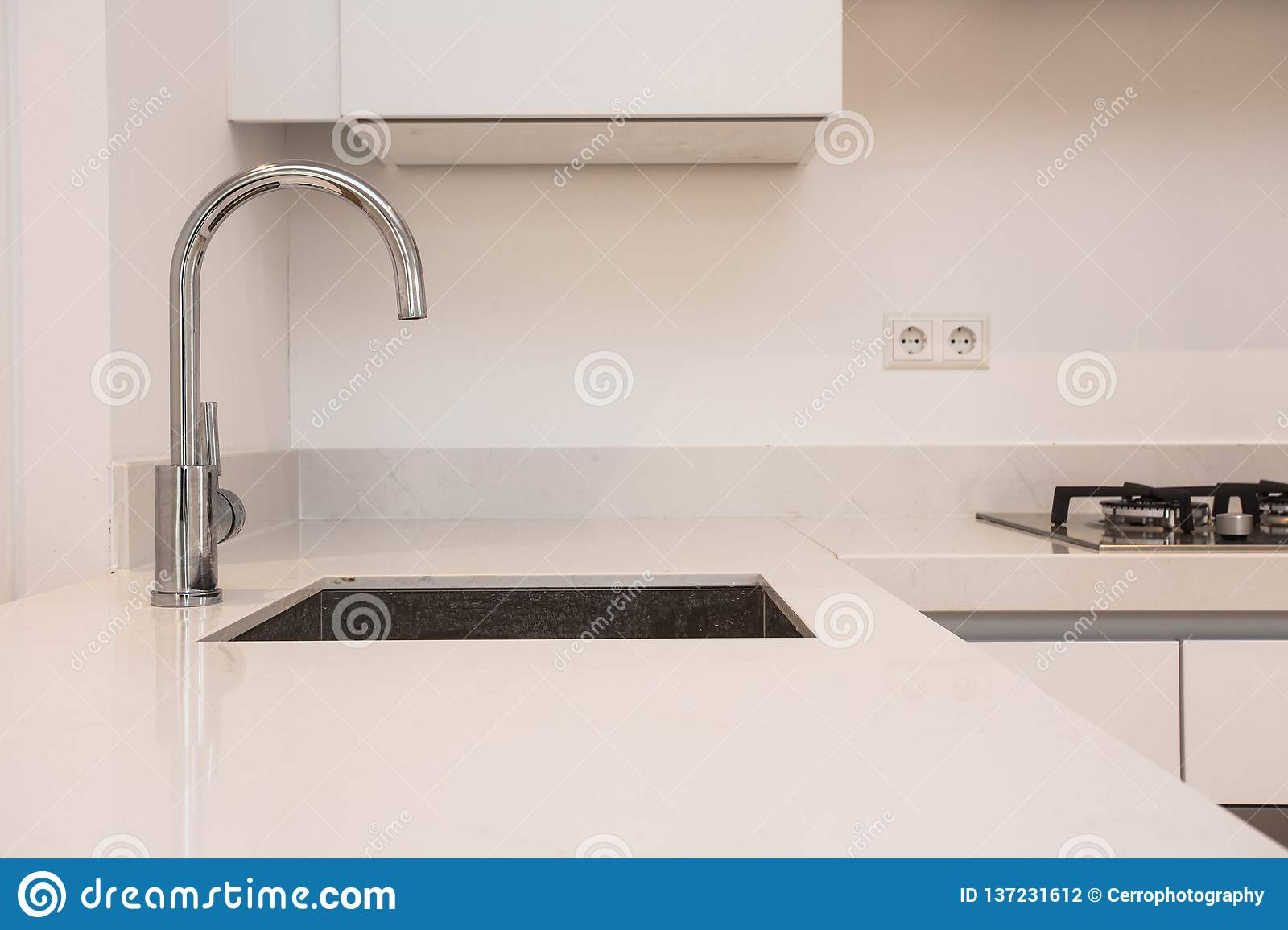 Luxurious modern kitchen with sink, Contemporary kitchen unit with chromed water tap modern white clean concept