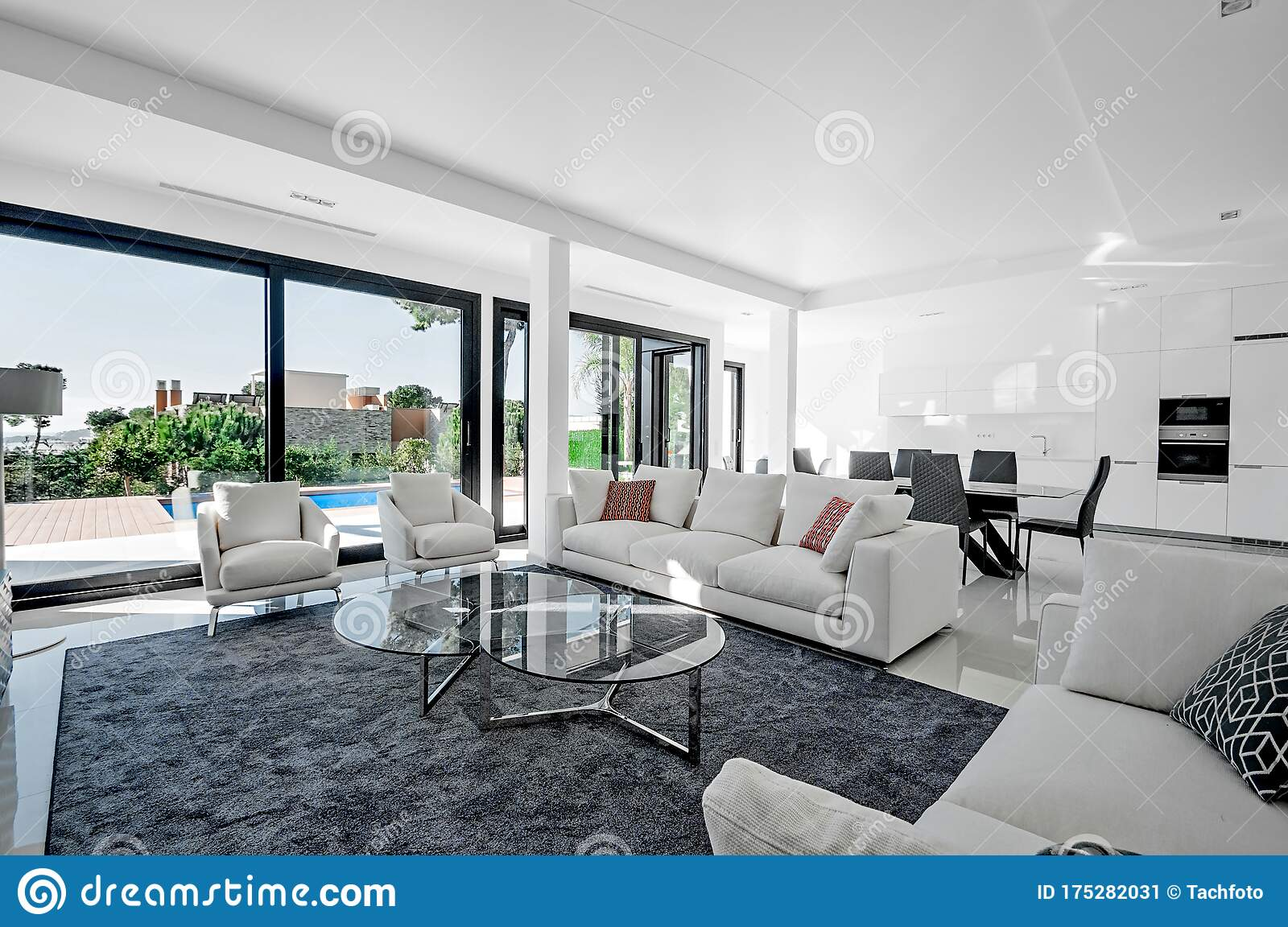 Luxurious And Modern Living Room Dining With Large Windows With Access To The Pool Luxurious Furniture Sofa Table And Chairs Stock Image Image Of House Luxurious 175282031