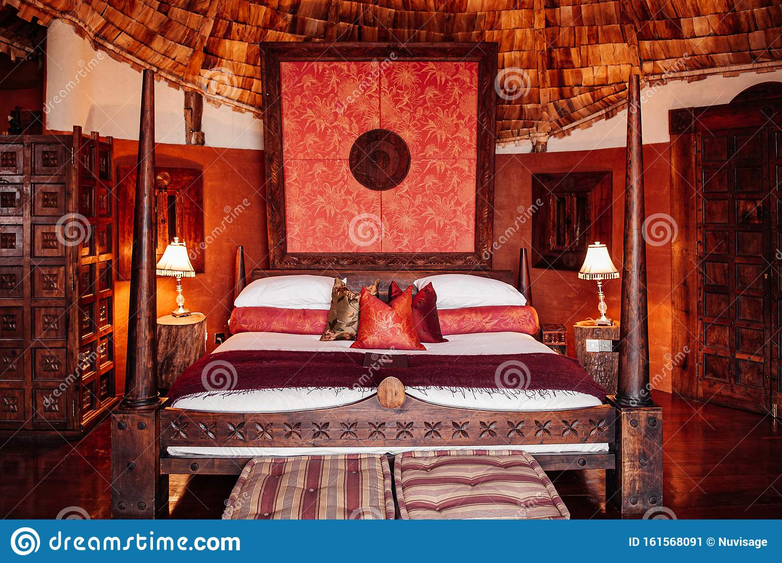 Luxury African Tribal Hut Bedroom Interior With Old Vintage Wooden Bed And Grand Wall Decoration Editorial Photo Image Of Patterned Interior 161568091