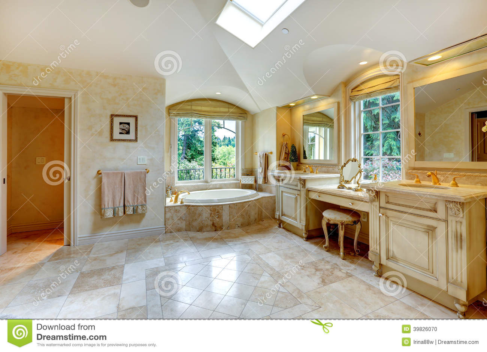 Luxury bathroom with antique vanity and cabinets stock for Luxury bathroom vanity cabinets