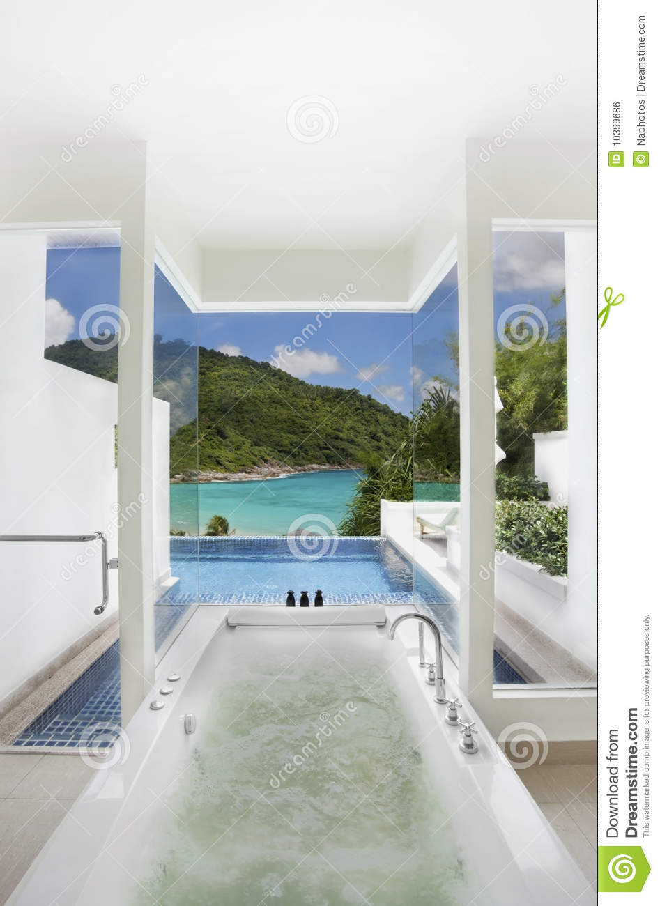 Luxury bathroom closes swimming pool and sea view stock for Small pool house with bathroom