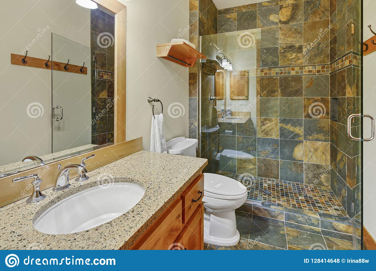 Luxury bathroom interior with natural stone tile