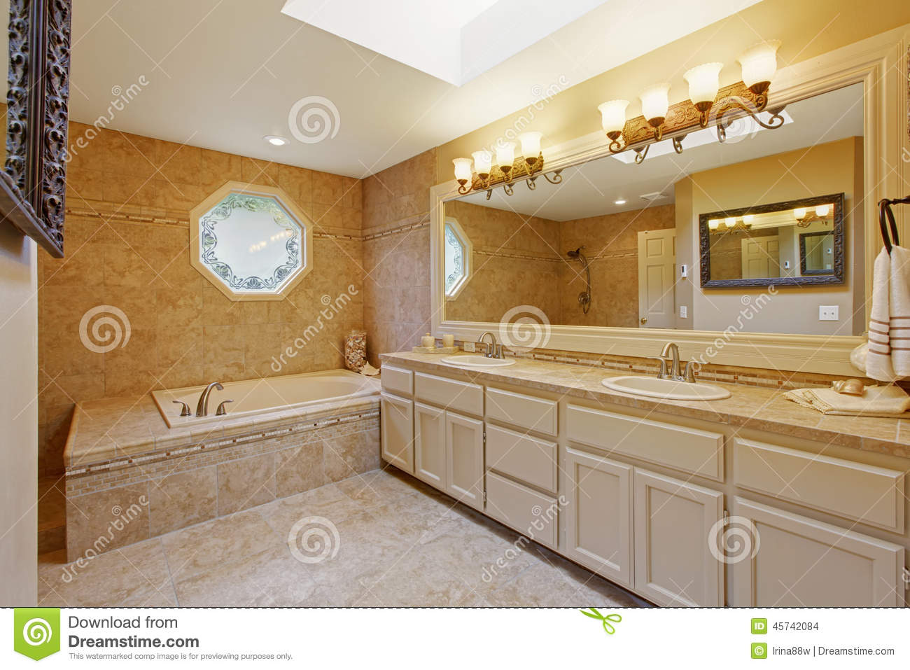 luxury bathroom interior with tile trim and big vanity cabinet with