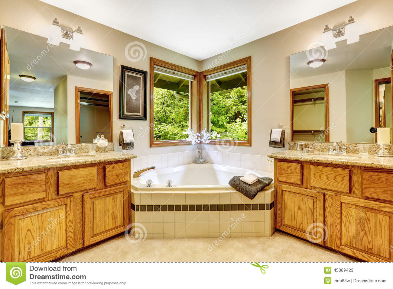 Luxury bathroom interior with two vanity cabinets and for Soaking tub in master bedroom