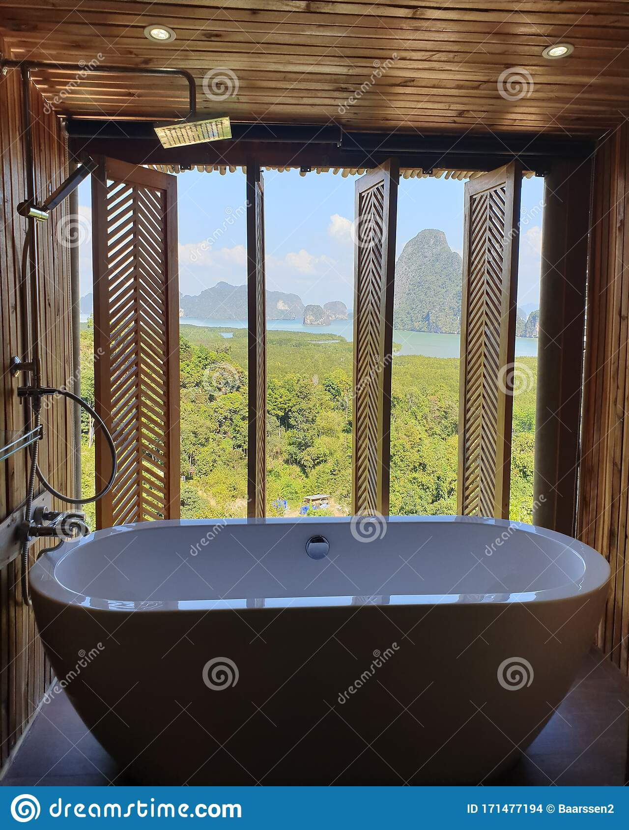 Luxury Bathroom Looking Out Over The Ocean Of Phangnga Bay Thailand Bath Tub In Wooden Room Stock Photo Image Of Design Shiny 171477194
