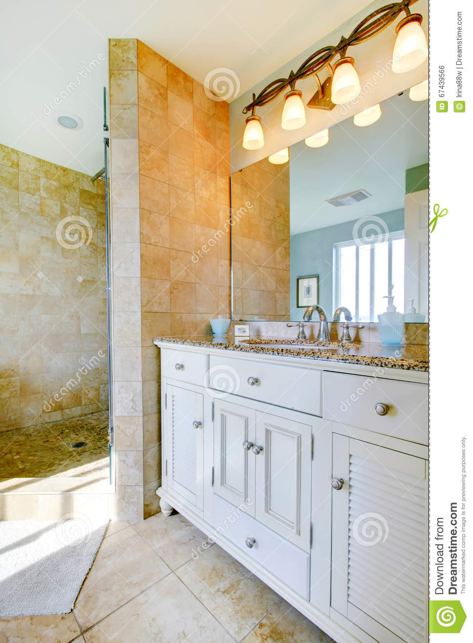 Luxury Bathroom With White Cabinets Marble Counters And Large Stock Photo Image Of Renovated Modern 67439566