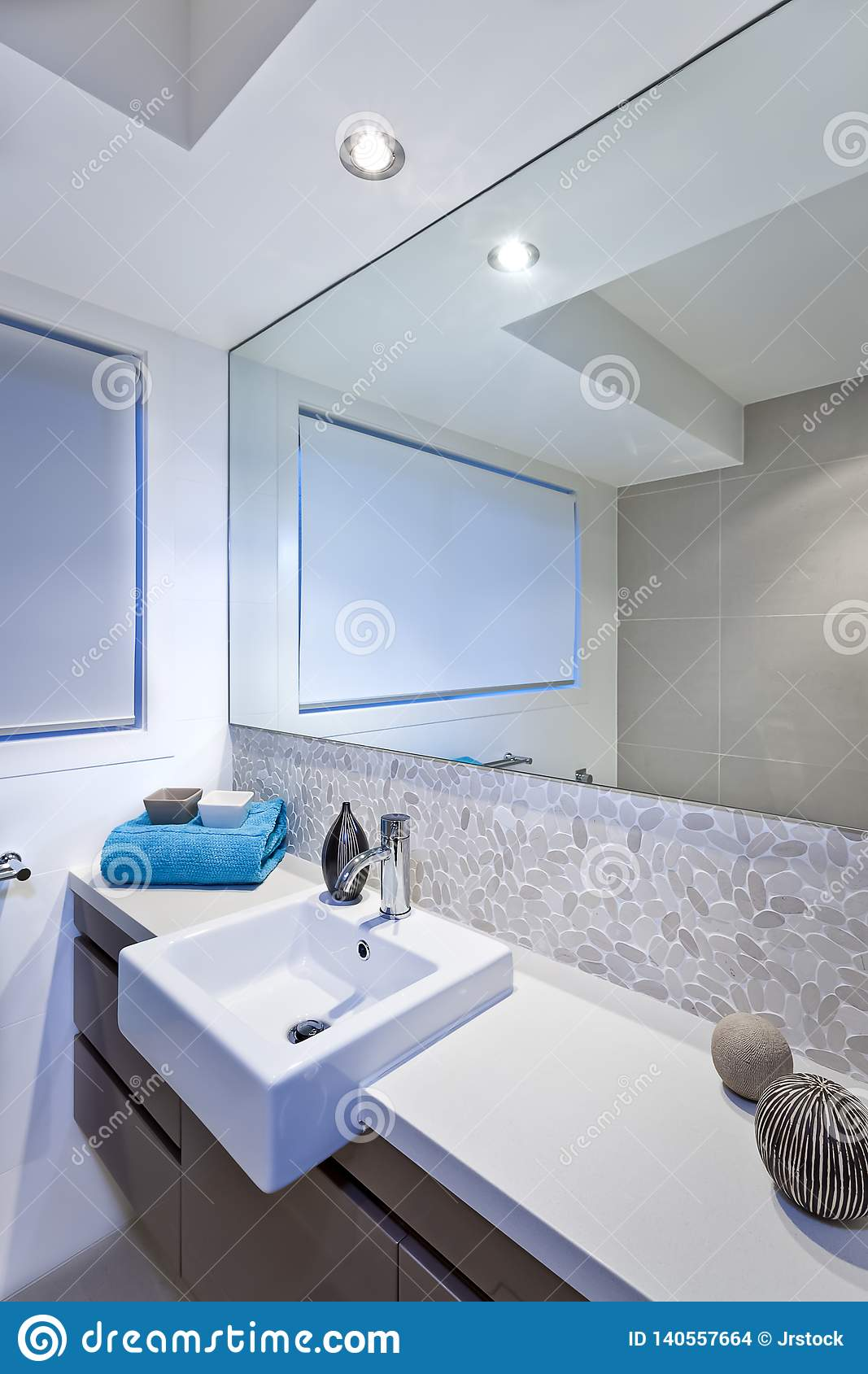 Luxury Bathroom With Wide Mirrors And Tap And Sink Stock Photo Image Of Modern Illuminated 140557664