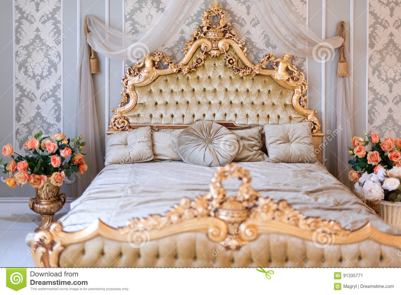 luxury bedroom in light colors with golden furniture details big comfortable double royal bed. Black Bedroom Furniture Sets. Home Design Ideas