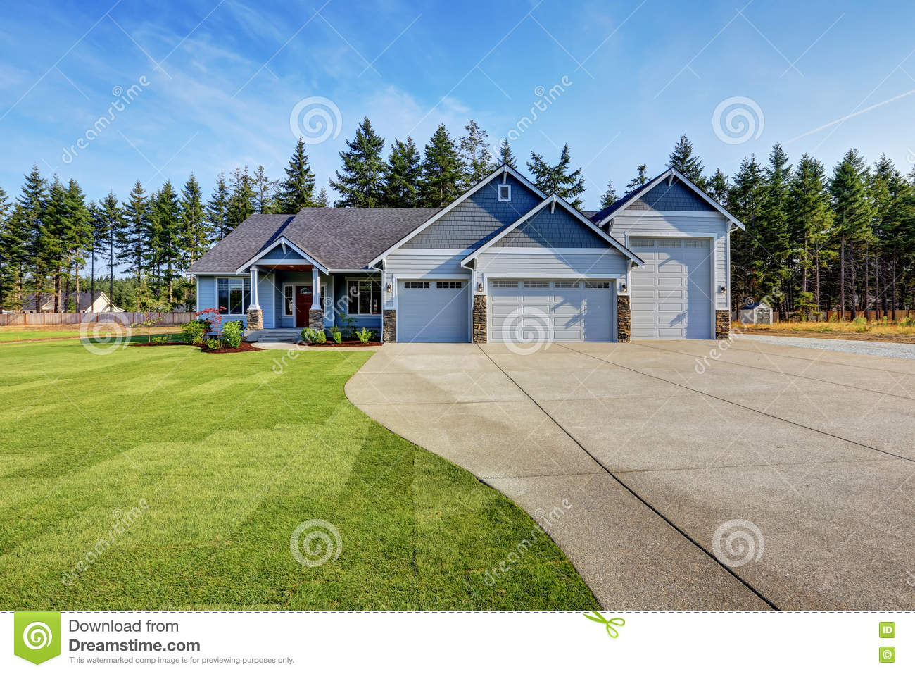 Luxury blue house with curb appeal three car garage for How wide is a 3 car garage