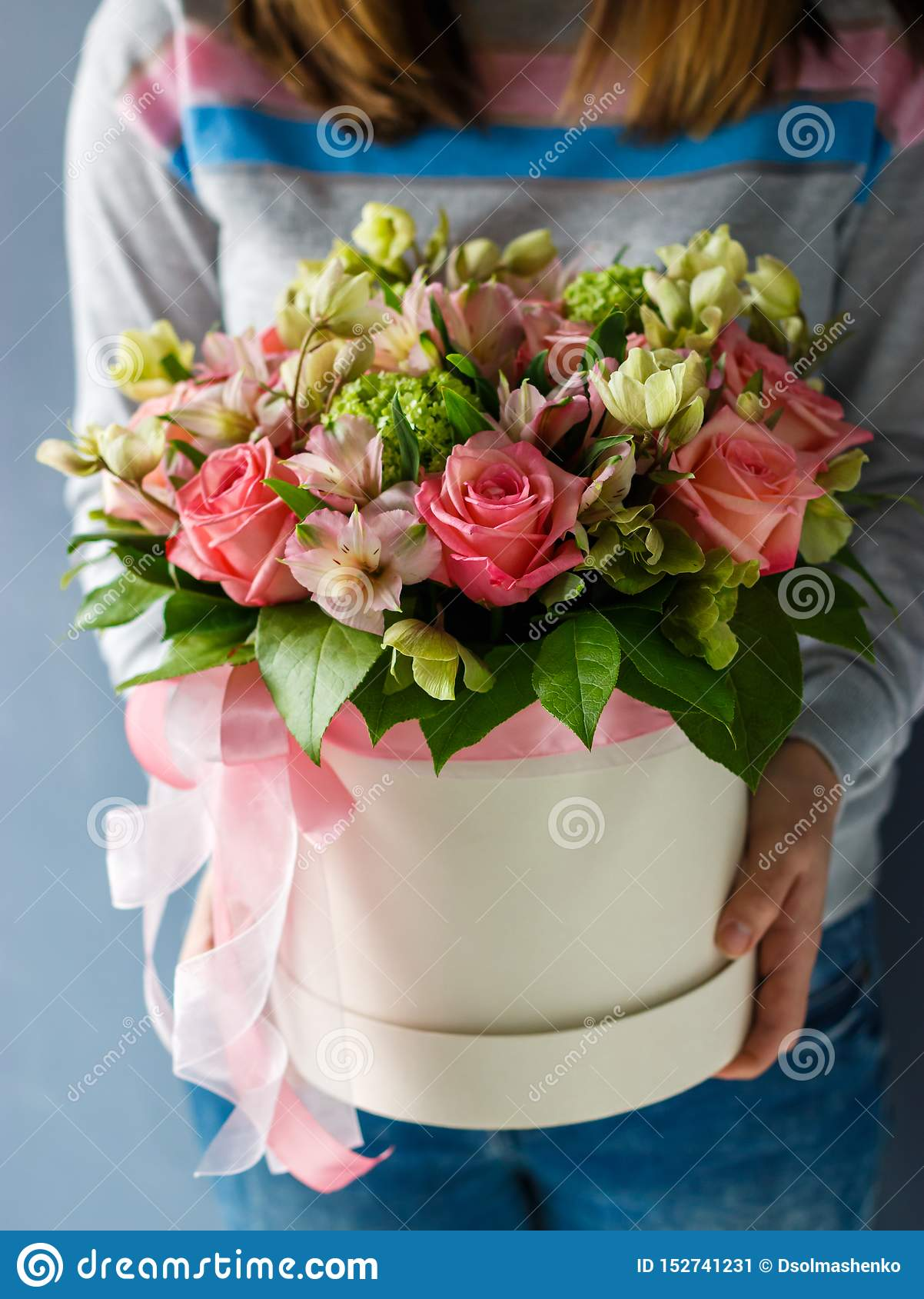 Luxury bouquets of different flowers in a hat box
