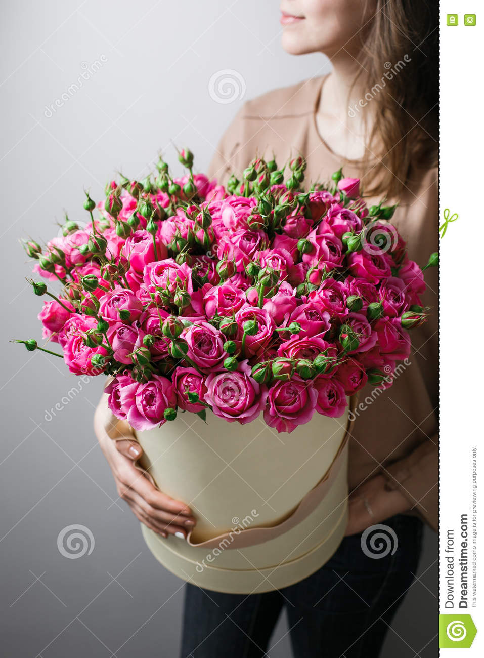 Luxury bouquets of flowers in the hat box roses in the hands women luxury bouquets of flowers in the hat box roses in the hands women pink colour peonies izmirmasajfo Choice Image