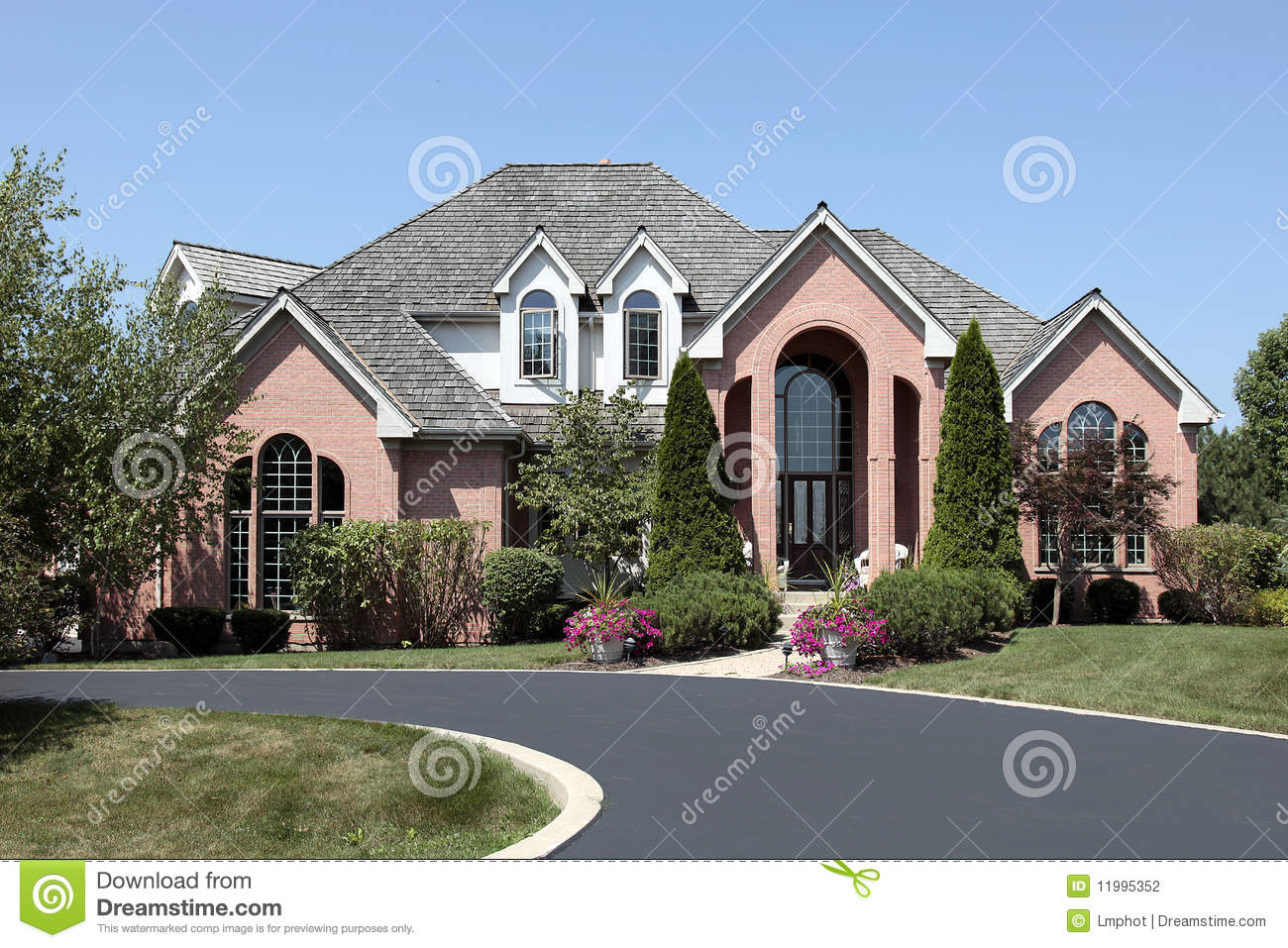luxury brick home with cedar roof stock photo image