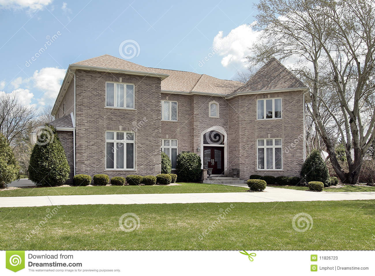 Luxury brick home with side garage stock photos image for House with side garage