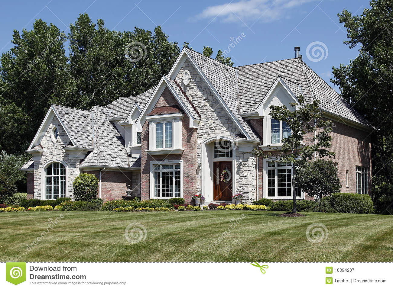 Luxury brick home in suburbs royalty free stock for Free luxury home images
