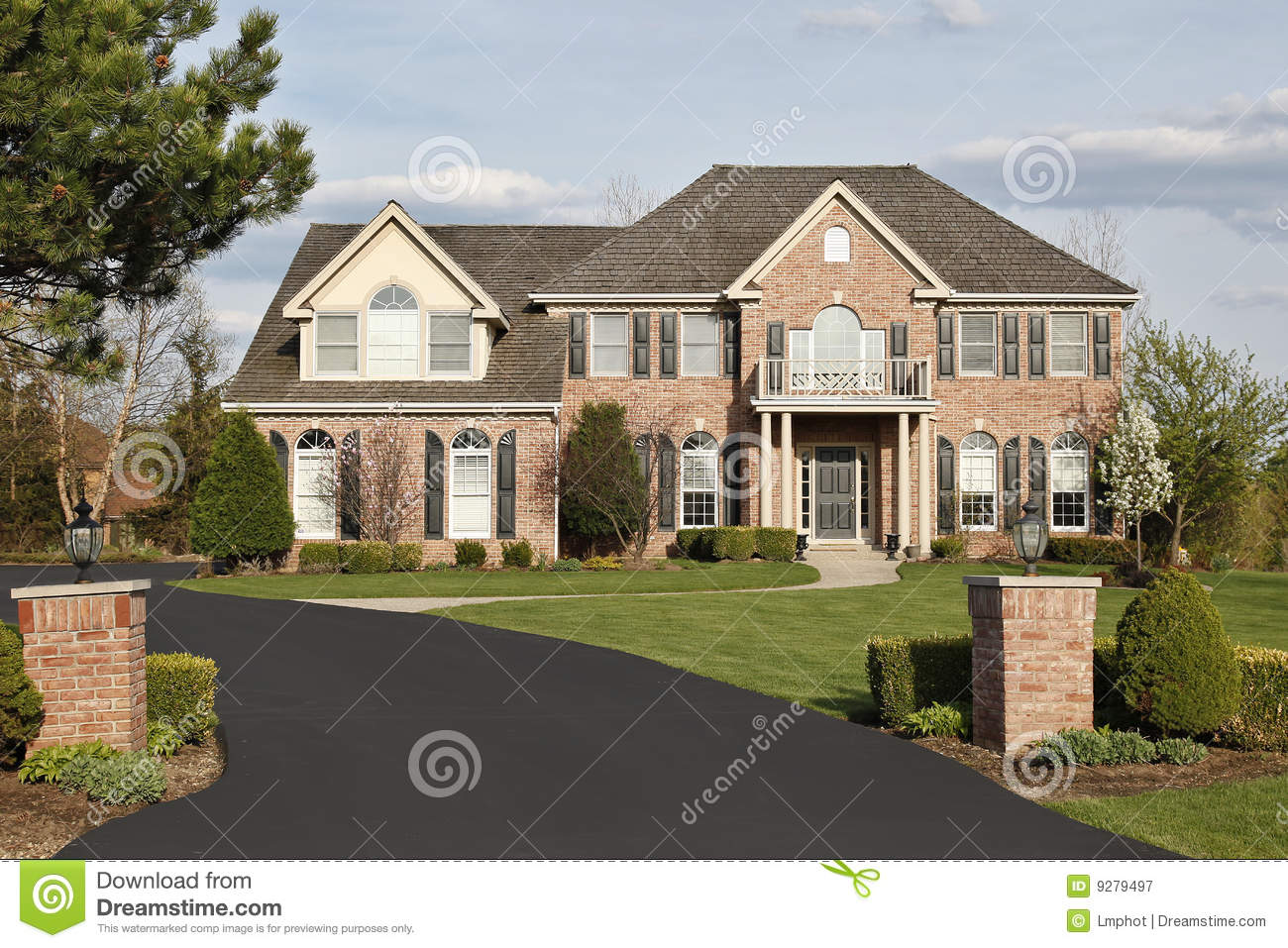Luxury brick home in suburbs royalty free stock