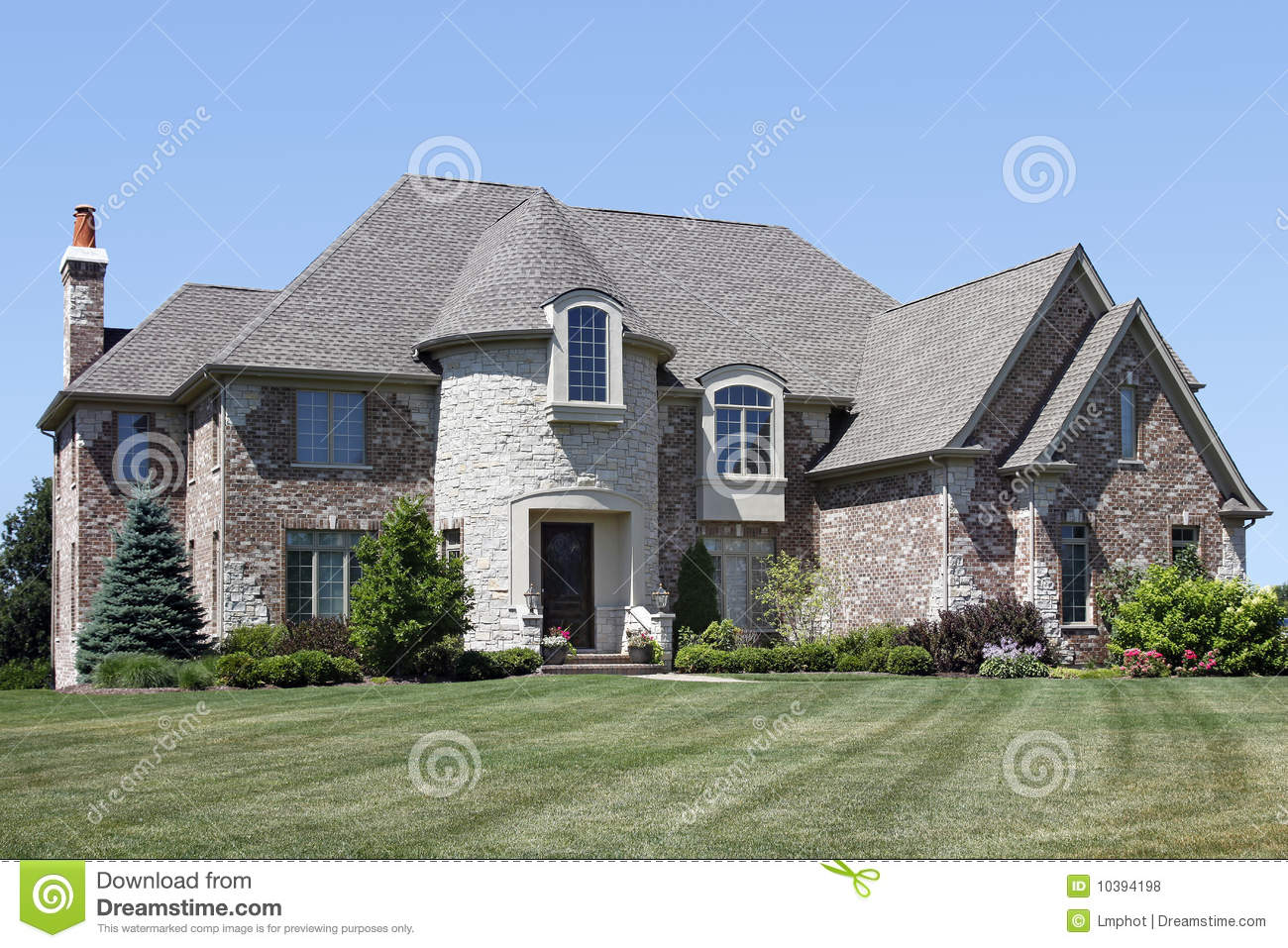 Luxury Brick Home With Turret Royalty Free Stock Photos