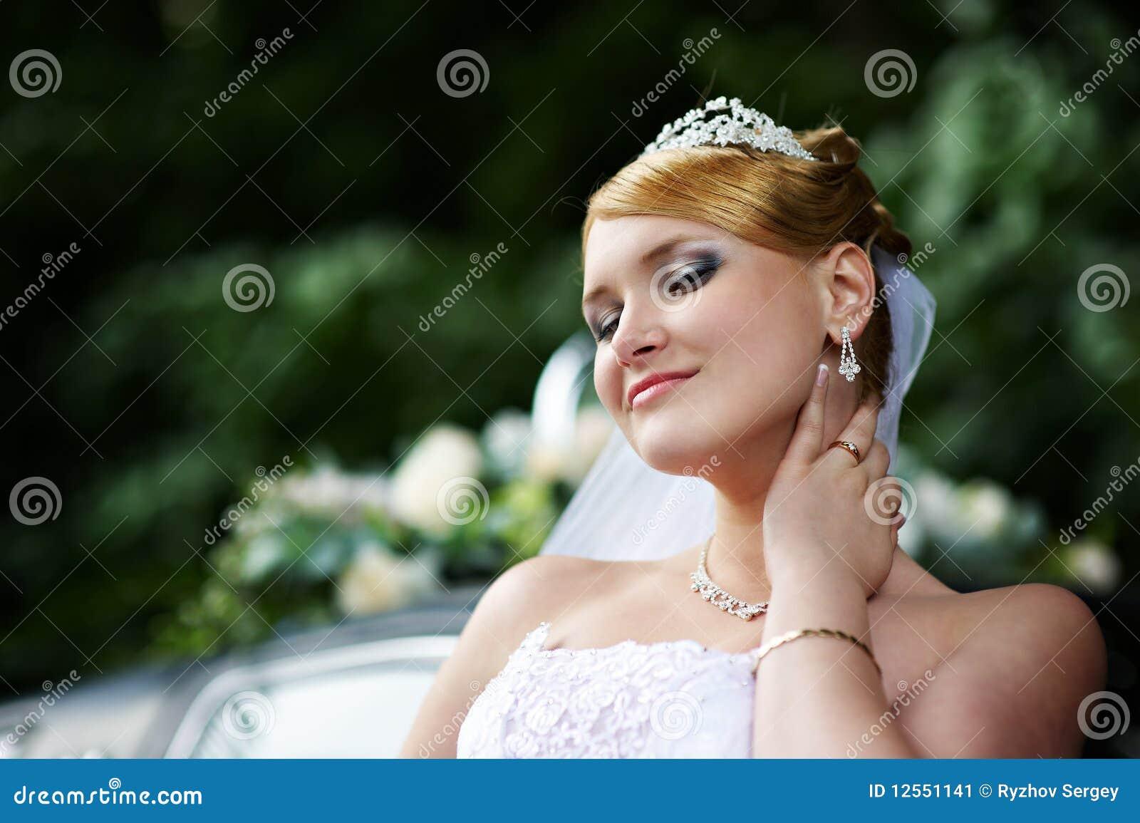 Luxury Bride With A Haughty Look In Wedding Dress Stock ...