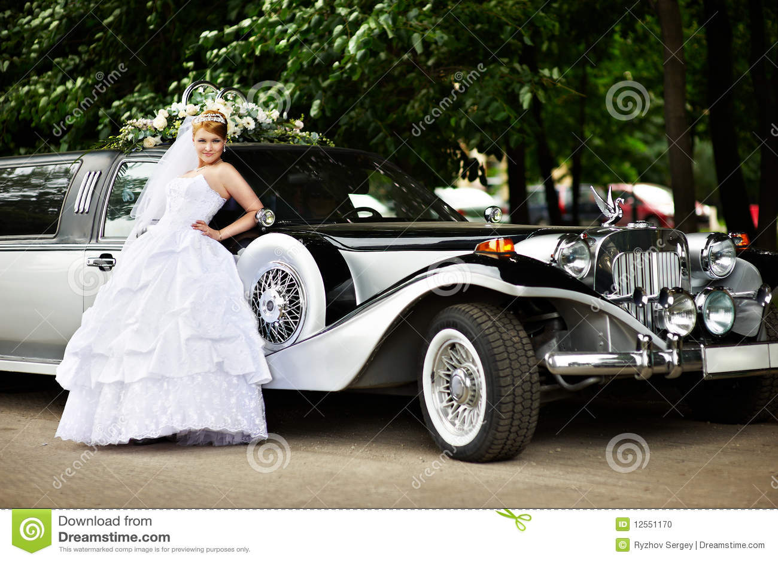Luxury bride in wedding dress about limousine