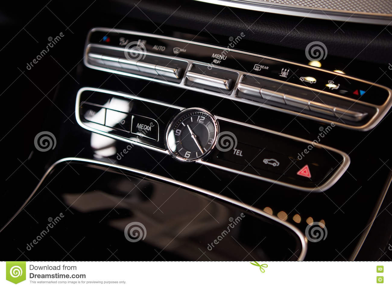 Luxury car interior details. Middle console with air and multimedia controls