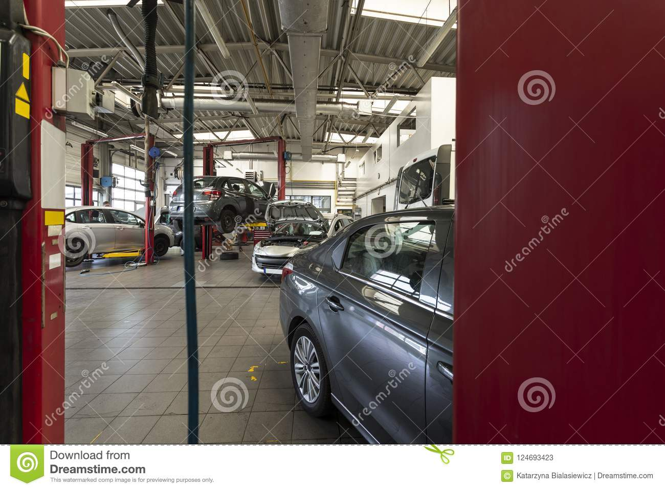 Luxury Cars Being Repaired In A Modern Garage View Through Red Stock Image Image Of Industry Indoors 124693423