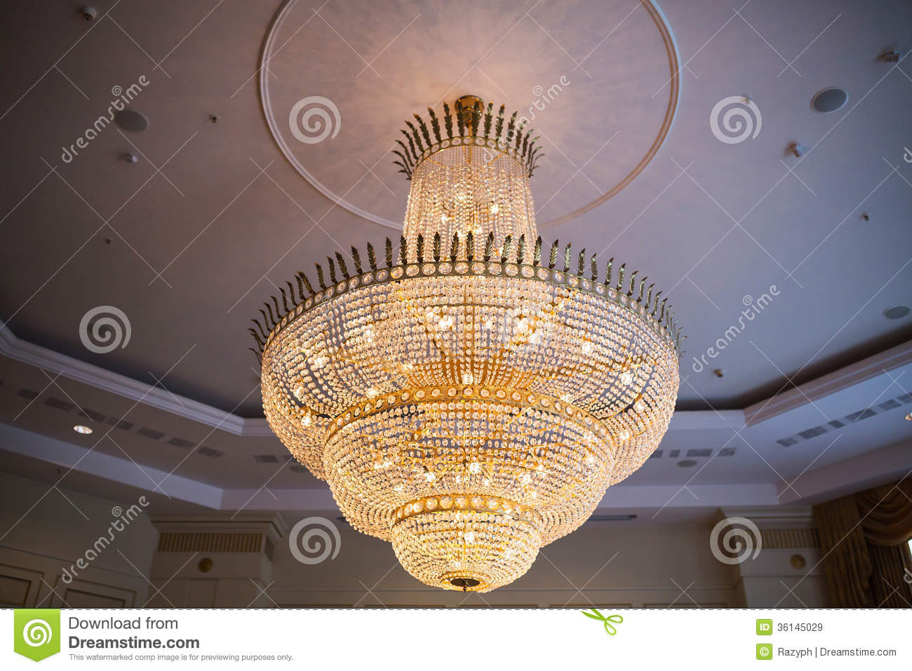 ... chandelier with crystals hanging from the ceiling of a ballroom
