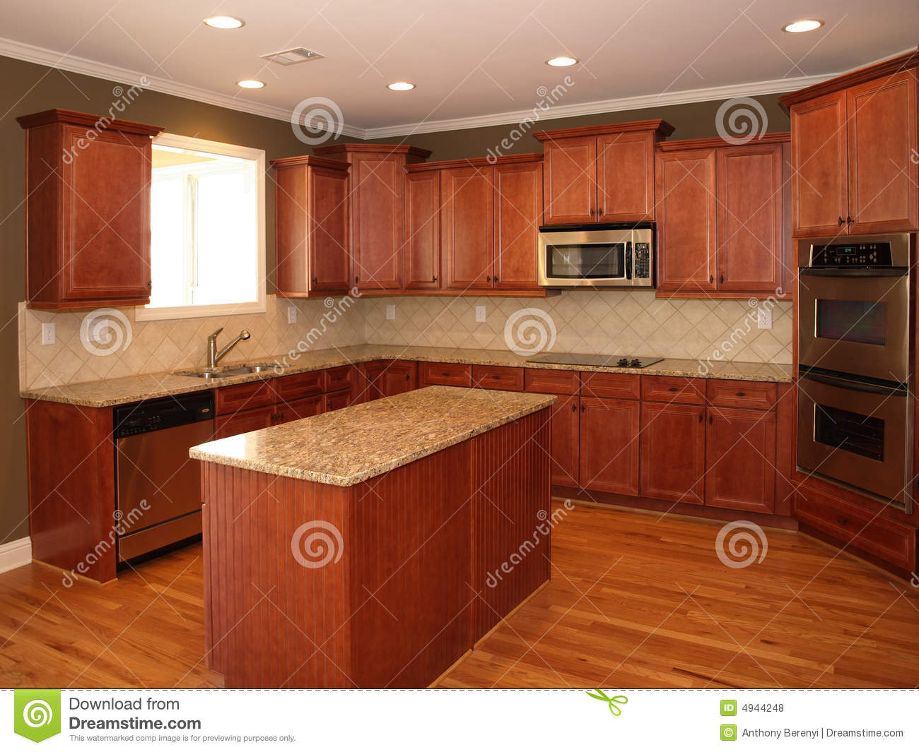 Luxury cherry wood kitchen with island stock photo image for Cherry wood kitchen cabinets price