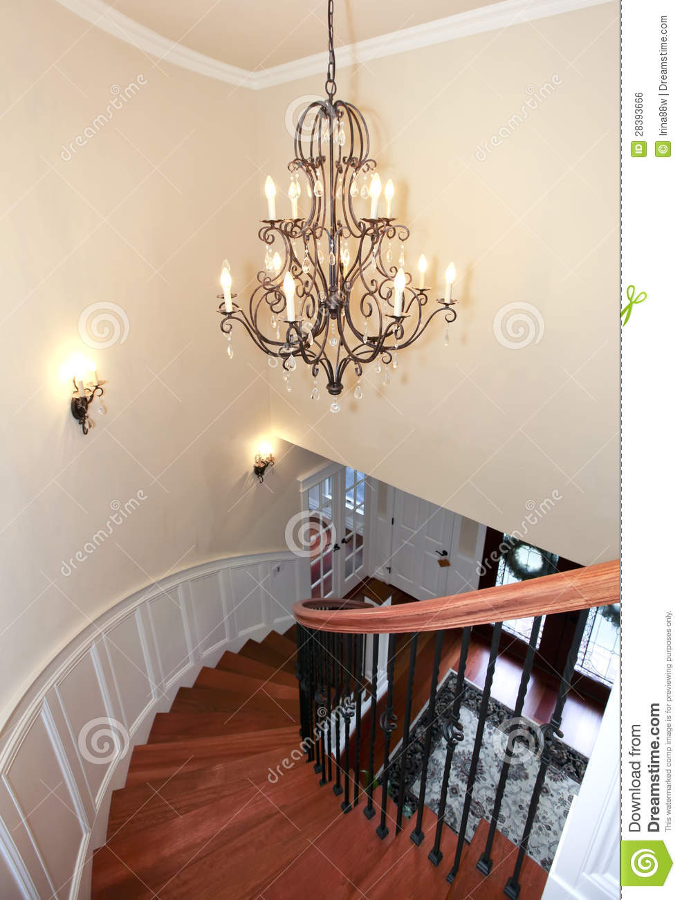 Luxury Curved Staircase With Chandelier And Harwood
