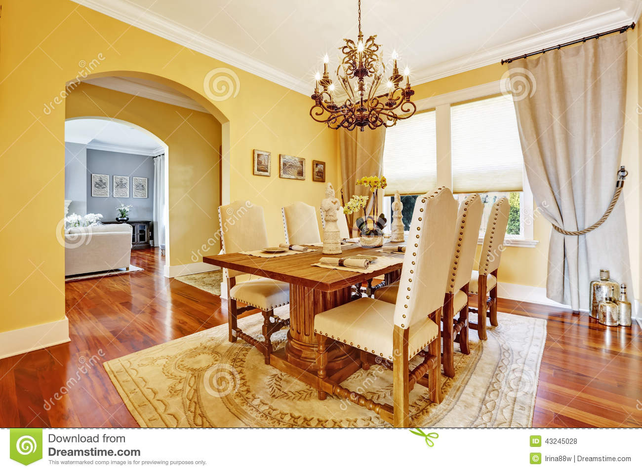 Salon Table À Manger luxury dining room with carved wood table stock photo