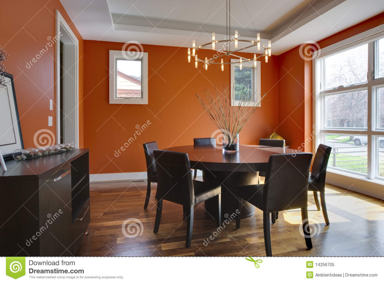 Luxury Dining Room With Orange Walls