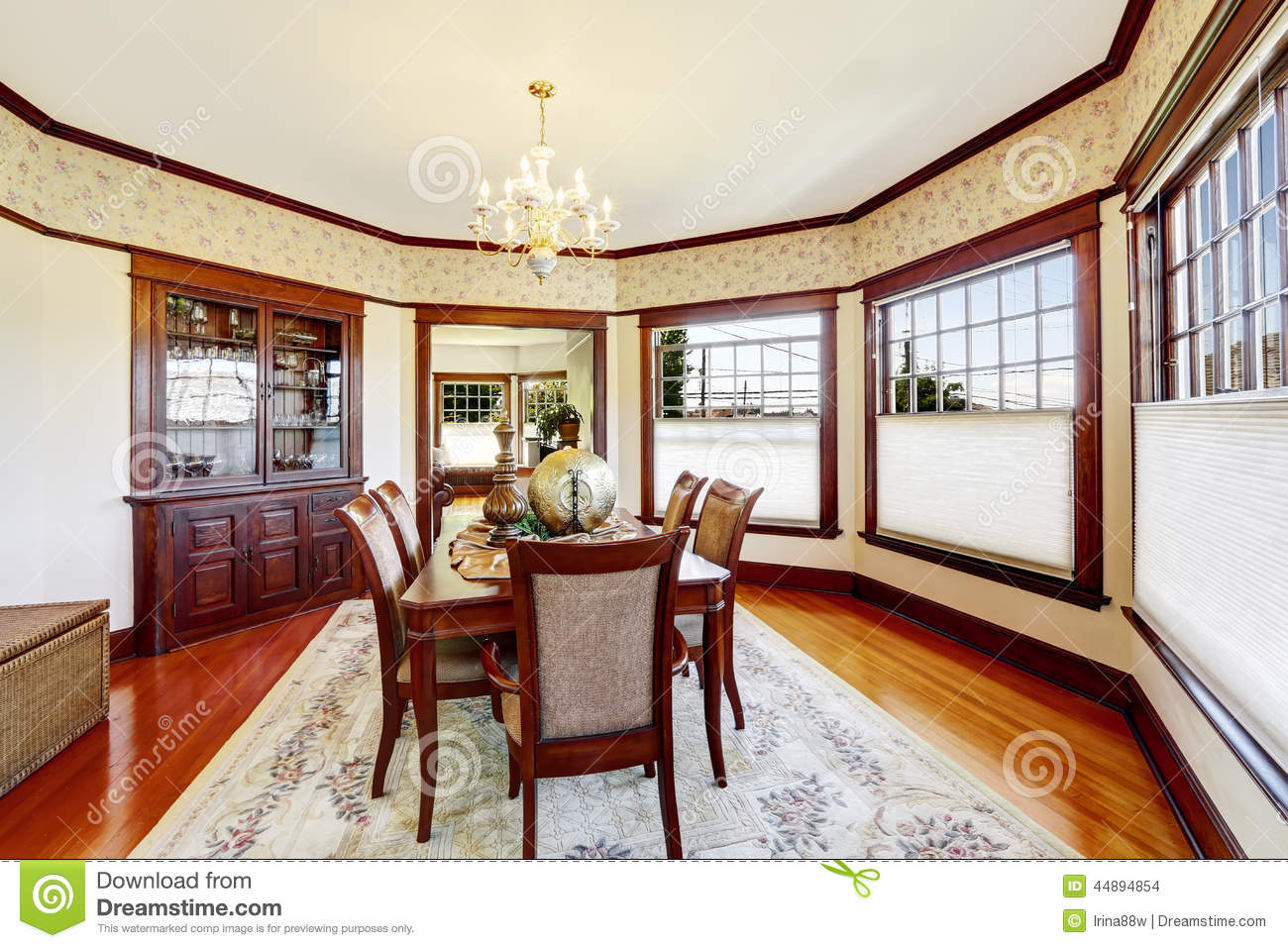 Luxury Dining Room With Wood Trim And Built in Cabinet