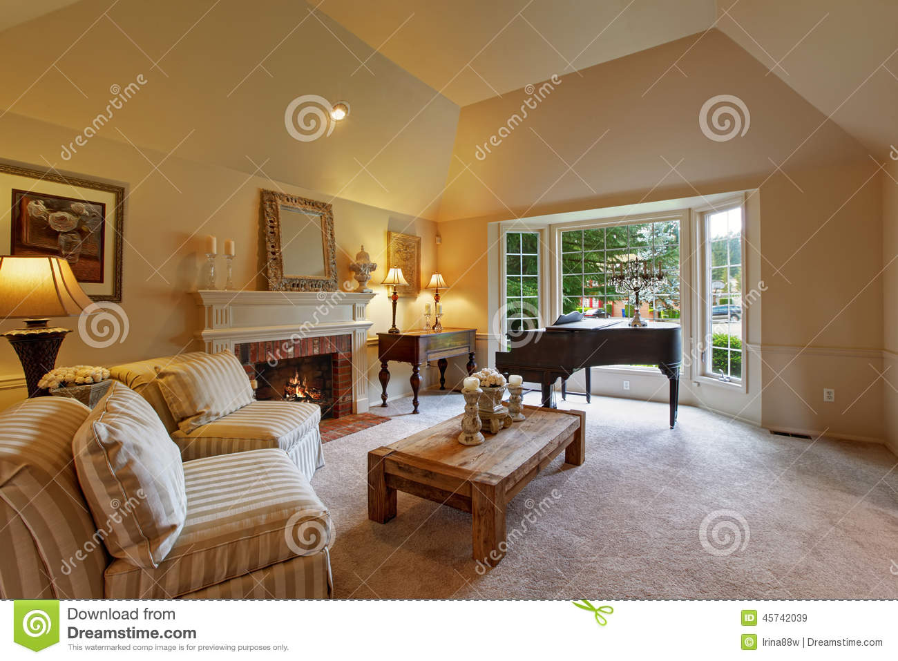 luxury family room with grand piano and fireplace stock photo