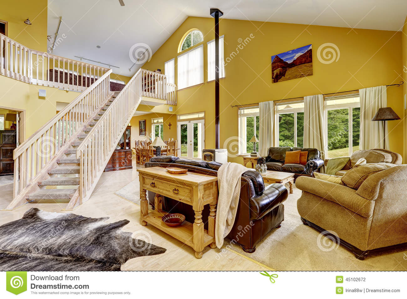 Stock Photo Luxury Family Room Rich Furniture Staircase To Loft Beautiful House High Vaulted Ceiling Wooden Spacious Leather Couches Image45102672 on Antique Style Living Room Sets