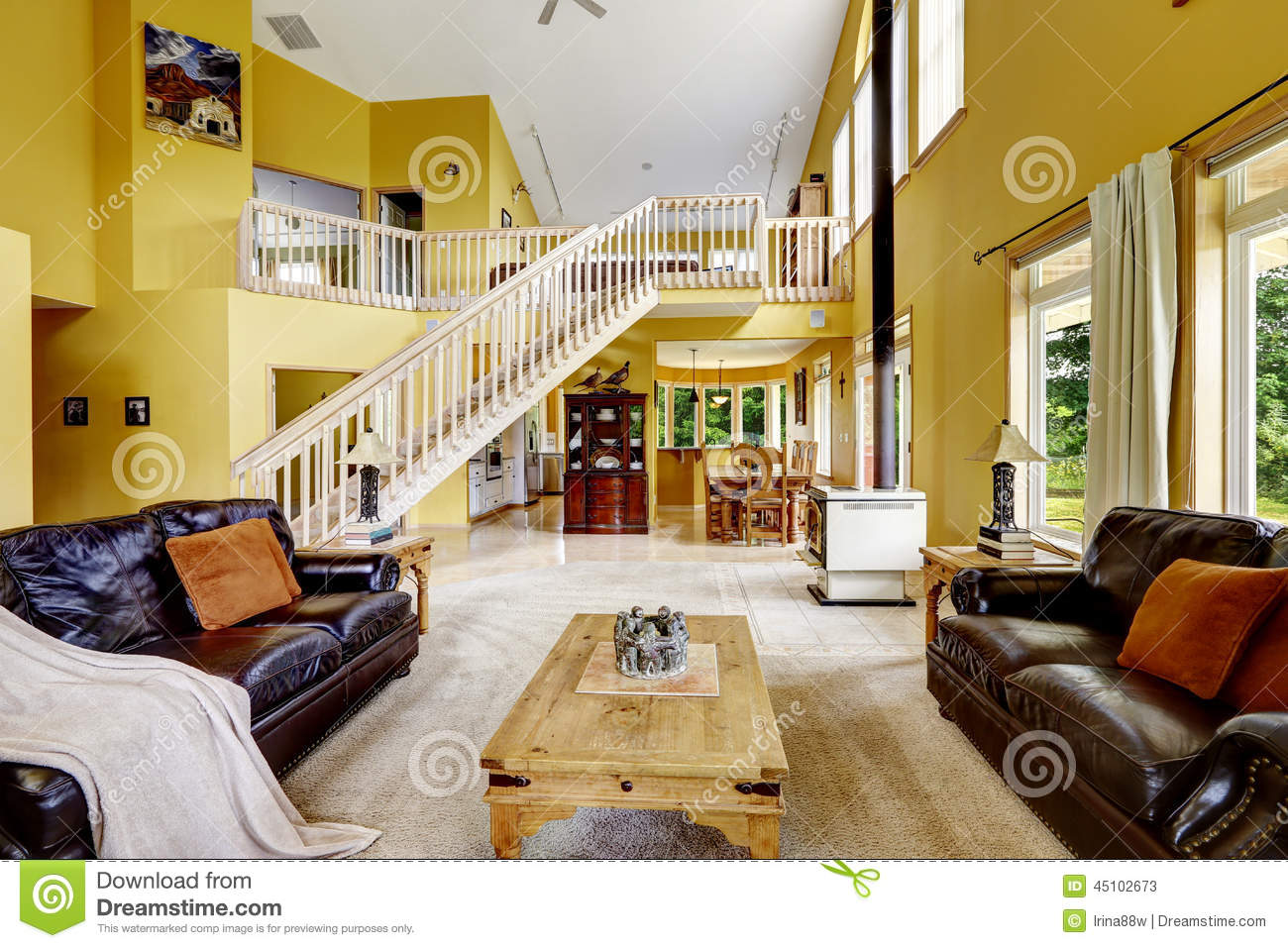 Luxury Family Room With Rich Furniture And Staircase To