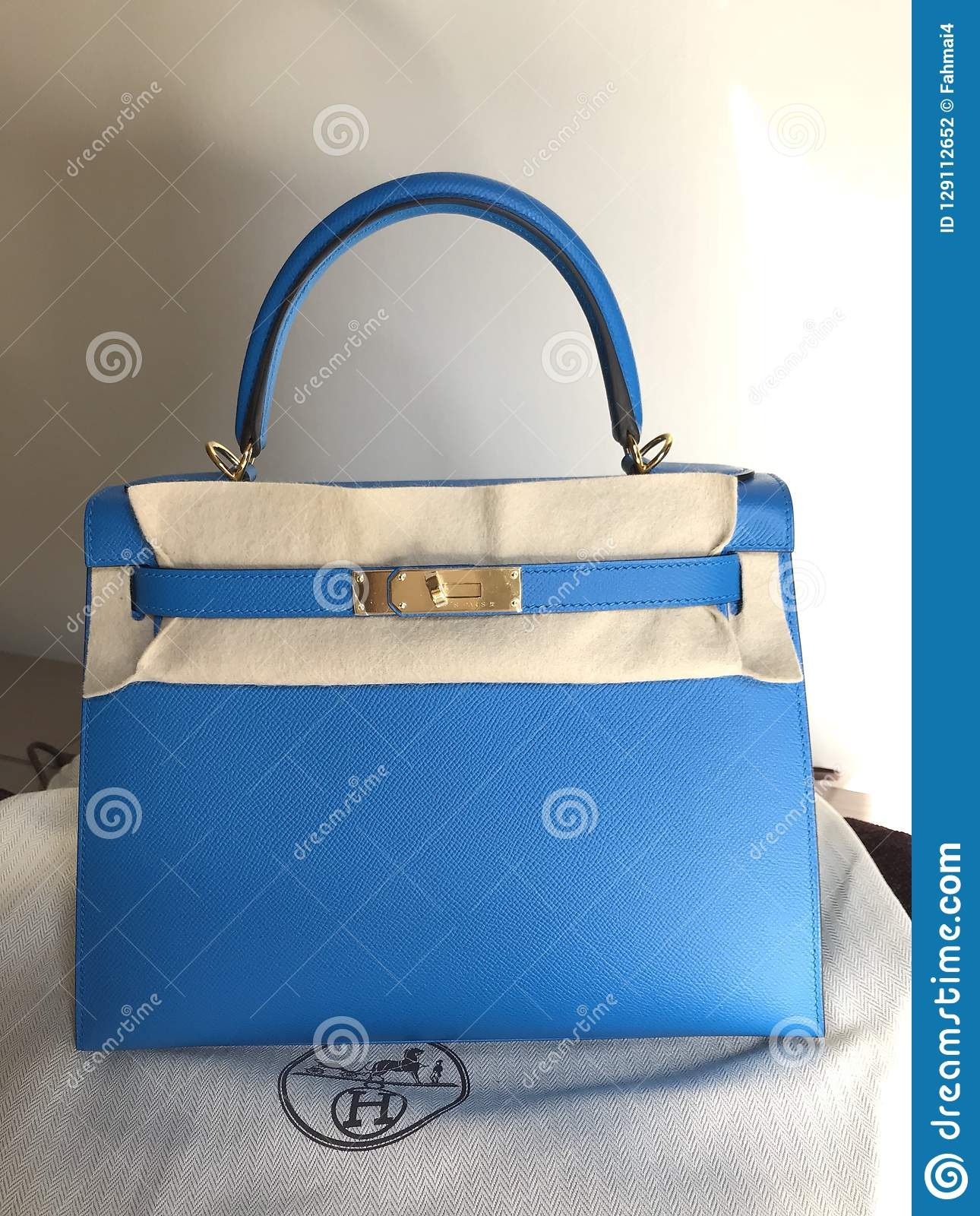 the luxury handbag Hermes kelly size 28 in blue zanzibar color epsom  leather and gold hardware. It is a dream bag for many women 161d68c49