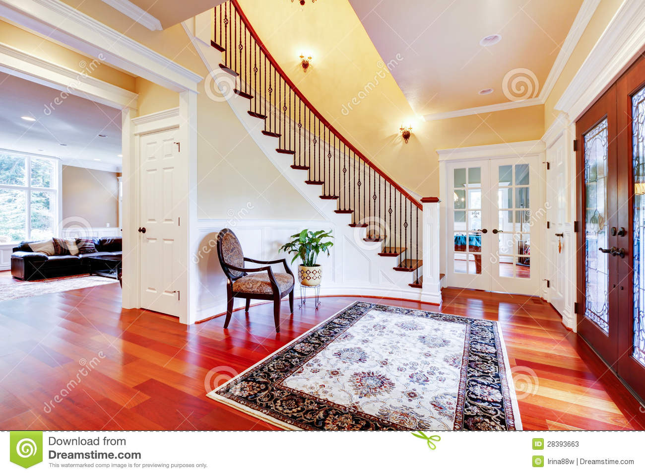 Luxury Home Entrance With Cherry Hardwood Floor And