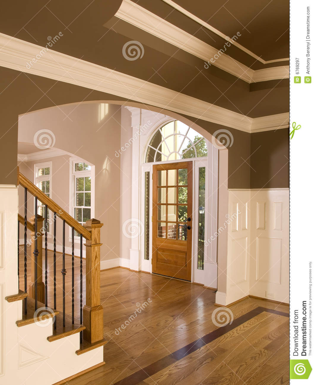 Luxury home entranceway with arch window royalty free for Luxury home windows