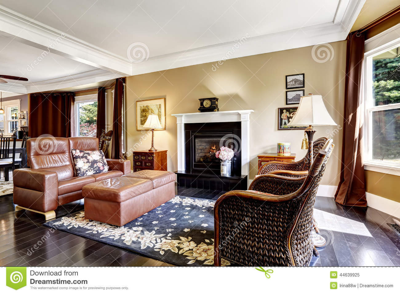 Luxury home interior with fireplace and leather couch Luxury fireplaces luxury homes