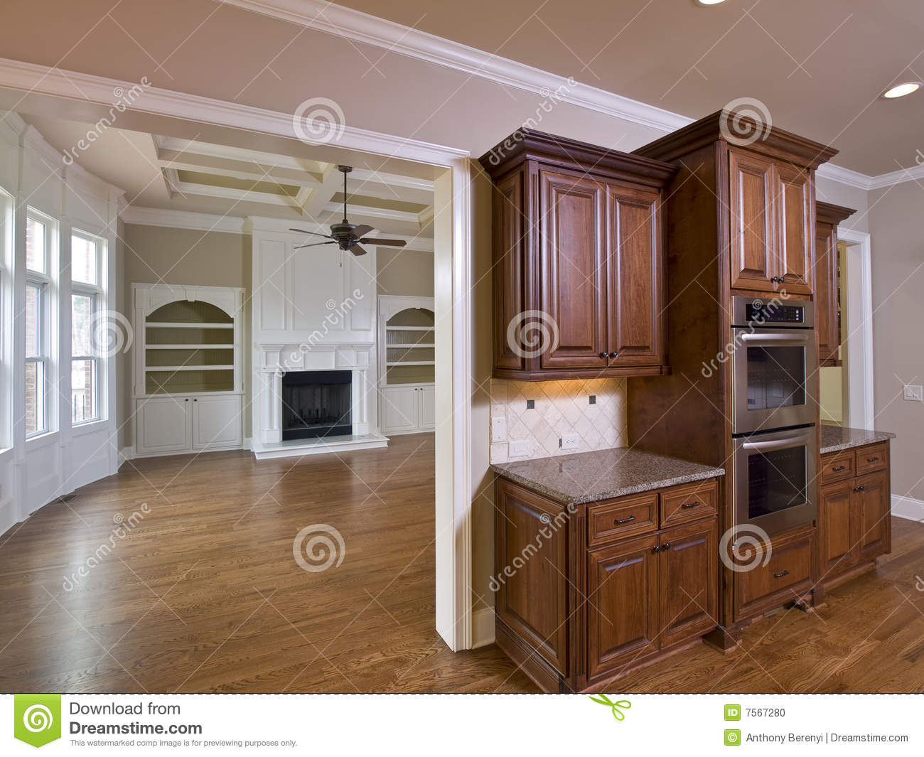 Luxury home interior kitchen cabinets and living room with fireplace