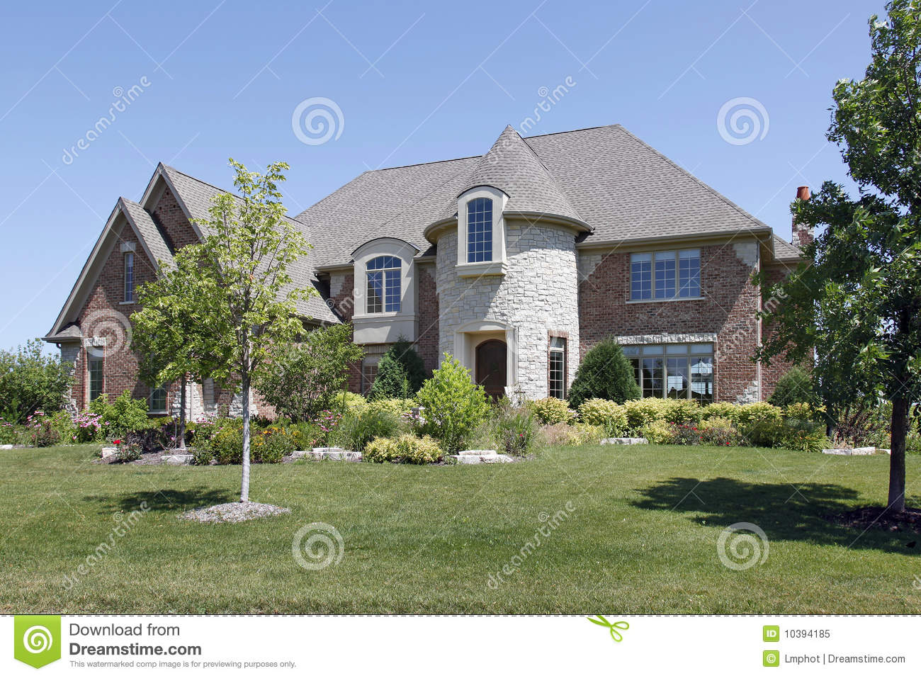 Luxury Home With Stone Turret Royalty Free Stock Photo