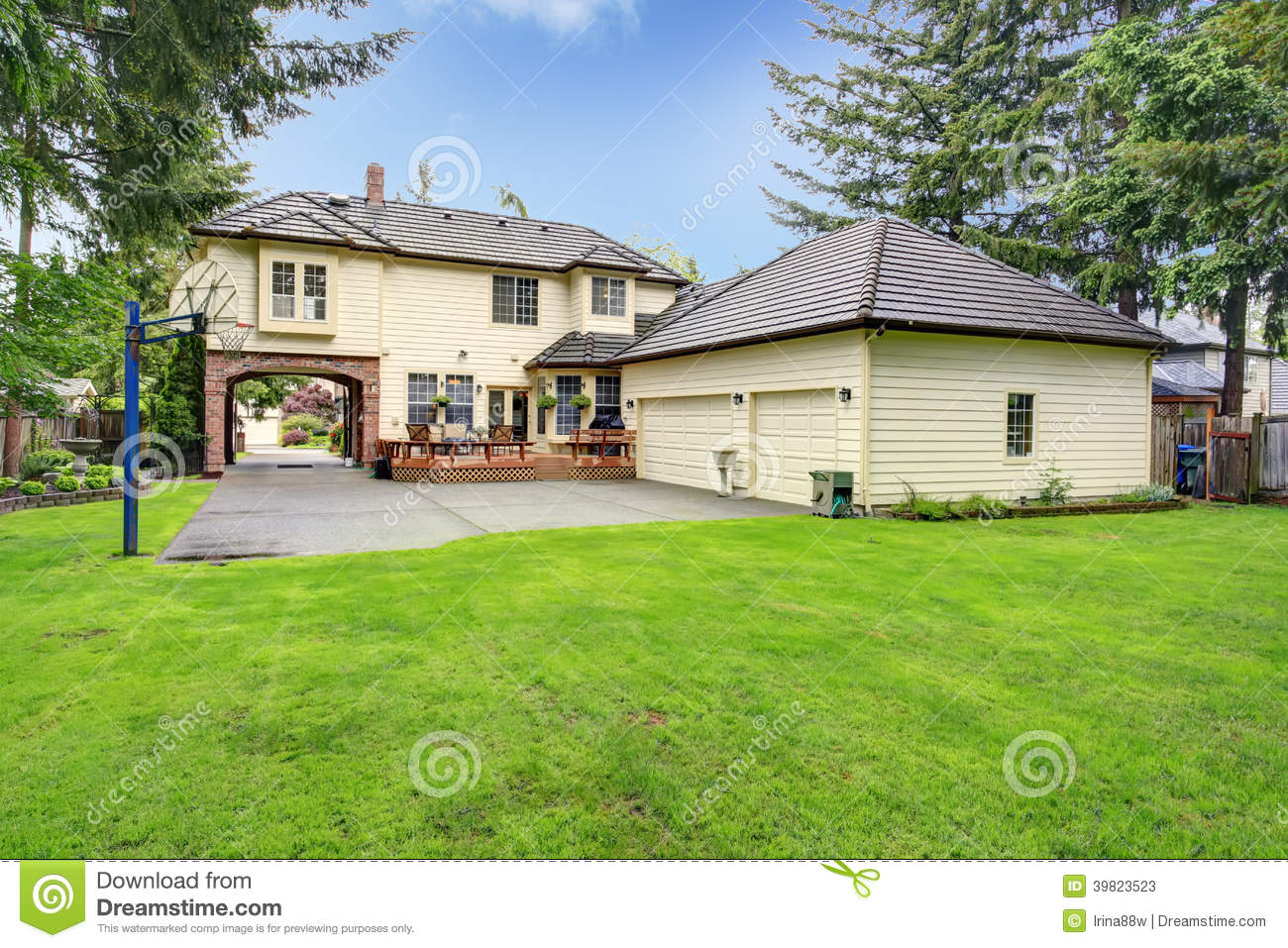 Luxury house backyard view stock image image of lawn for Patio home plans with garage