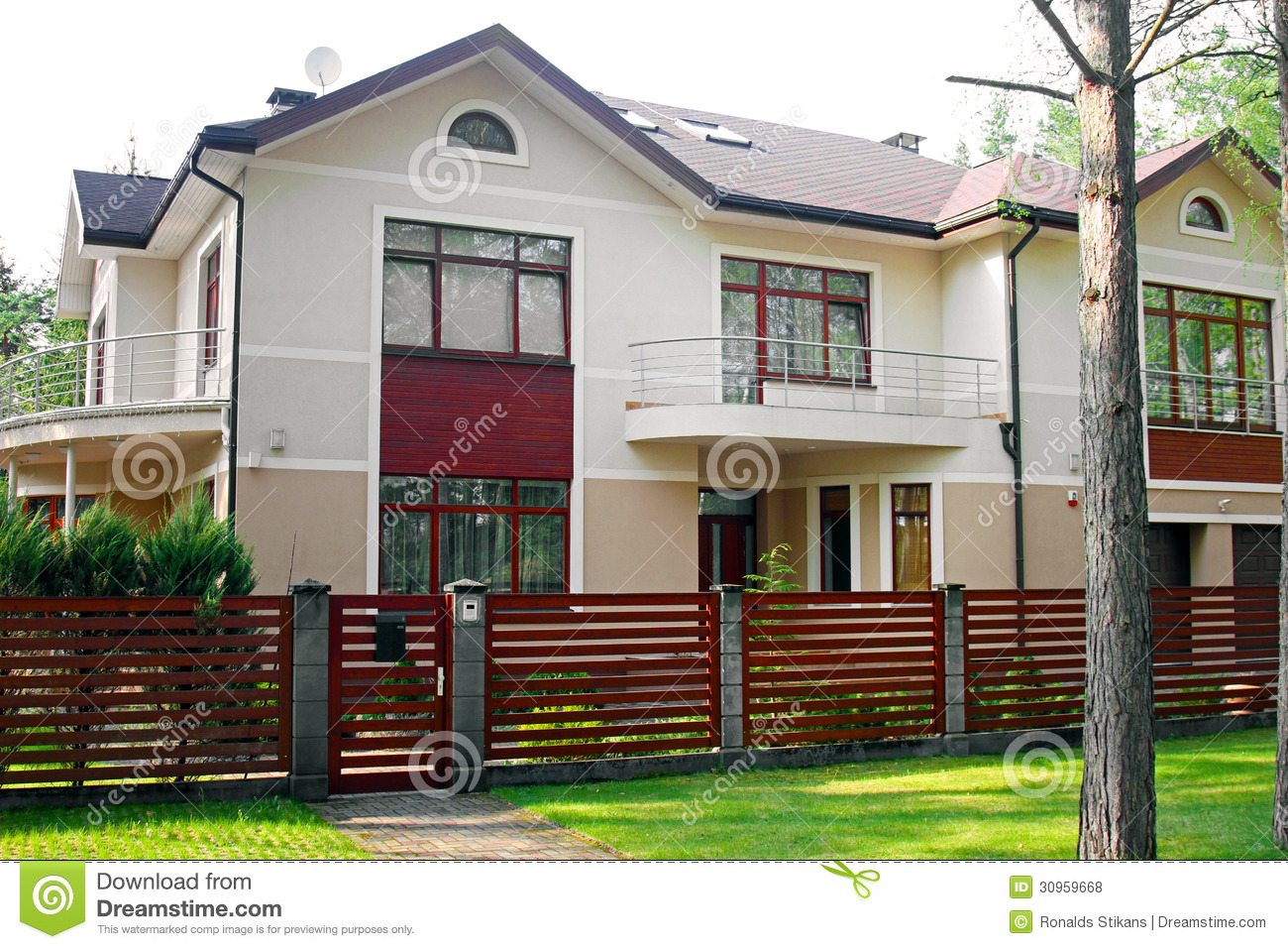 Luxury House With Fence And Green Grass Stock Photo