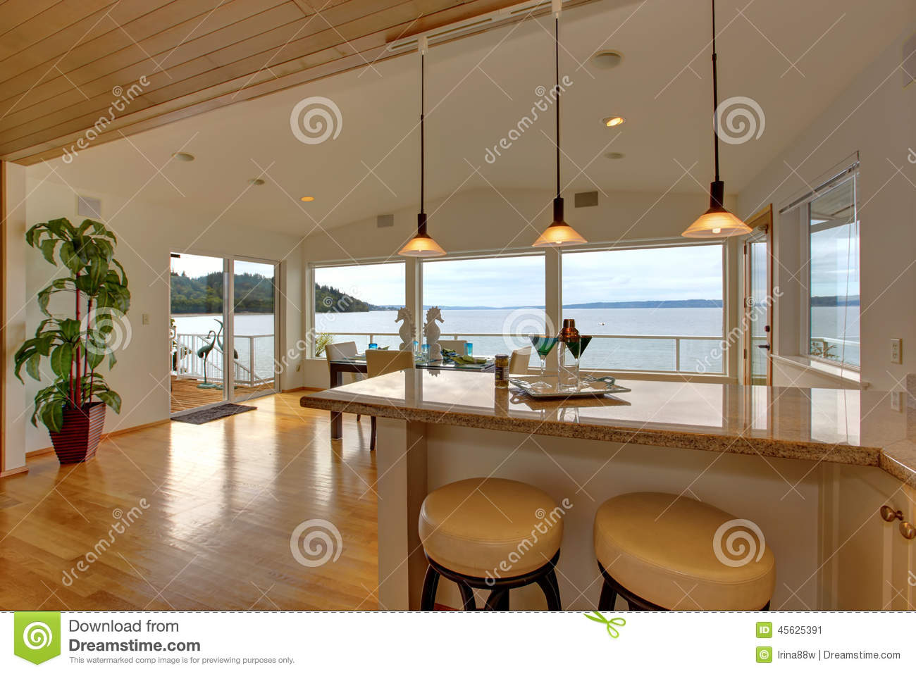 Luxury House Interior. Bar Counter Top With Stools And Dining Ar