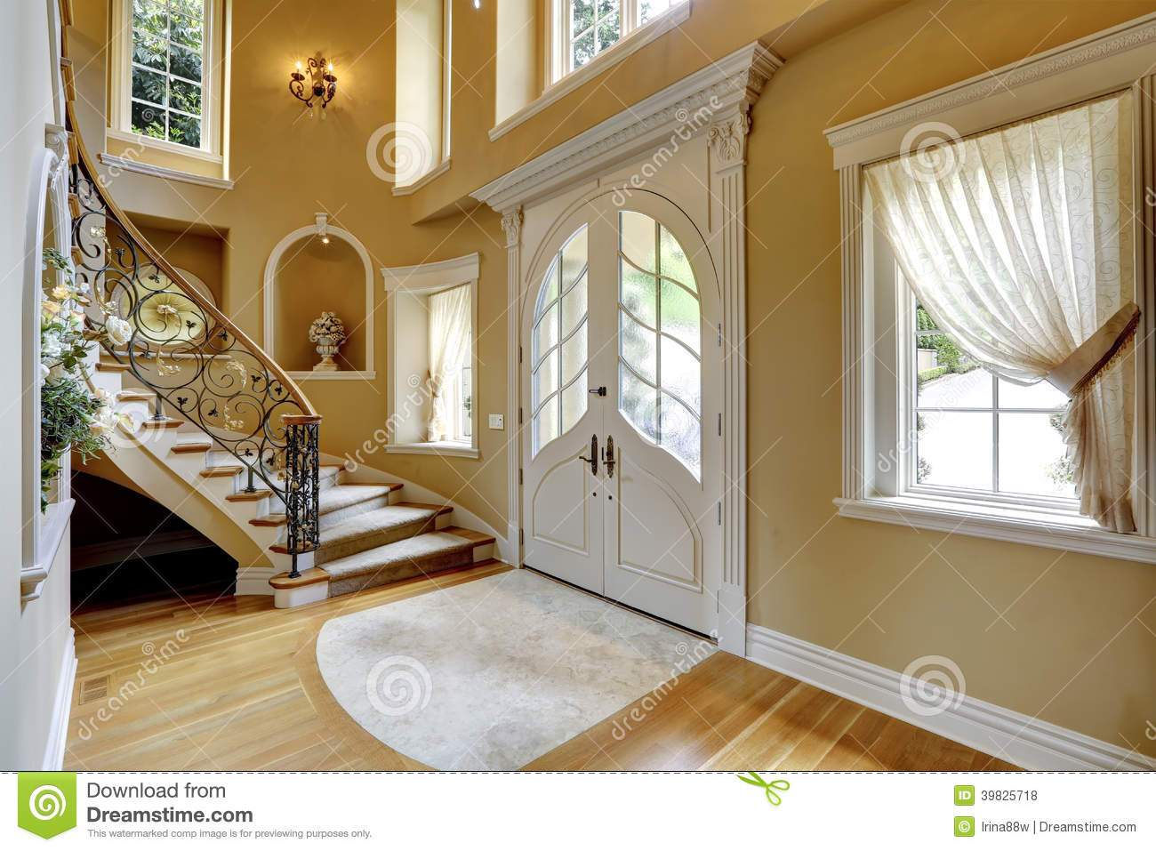 Beautiful High Ceiling Entrance Hall With Staircase And Decorated