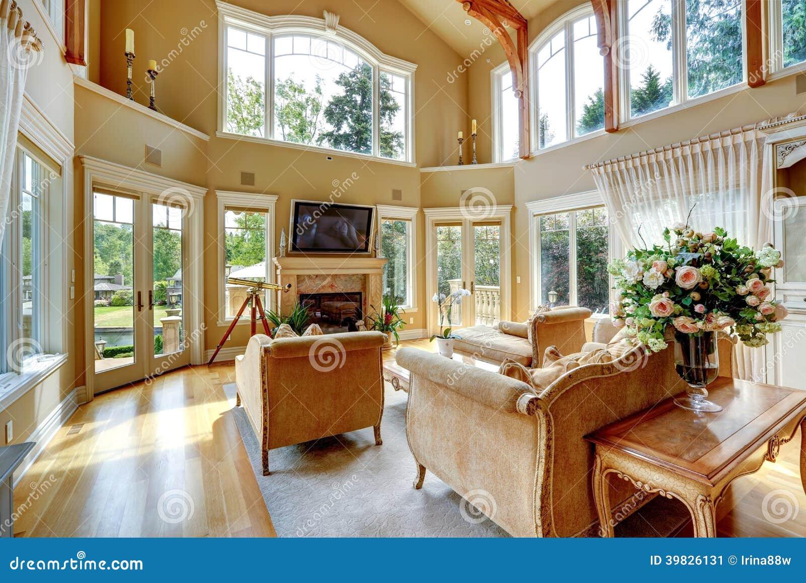 Luxury house interior living room with walkout deck stock for Sala de estar antigua